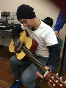 Ibi playing Guitar